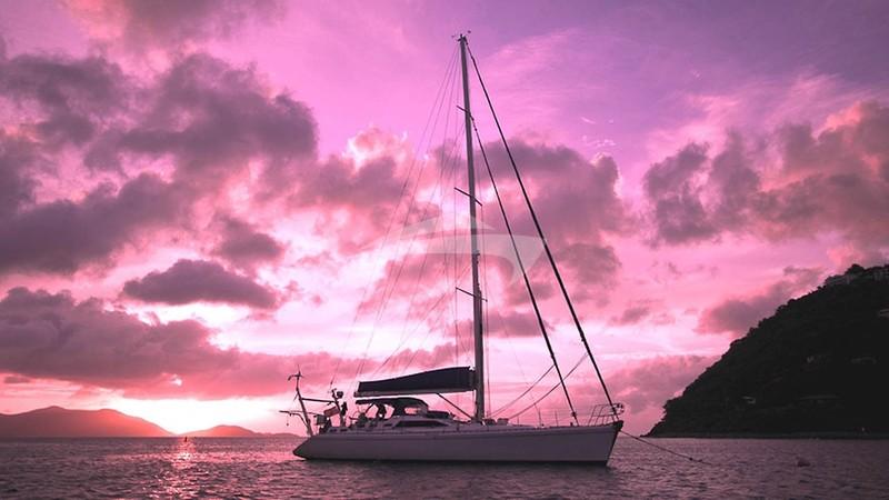 Scorpio in the sunset at Leverick Bay, BVI - SCORPIO Charter Yacht