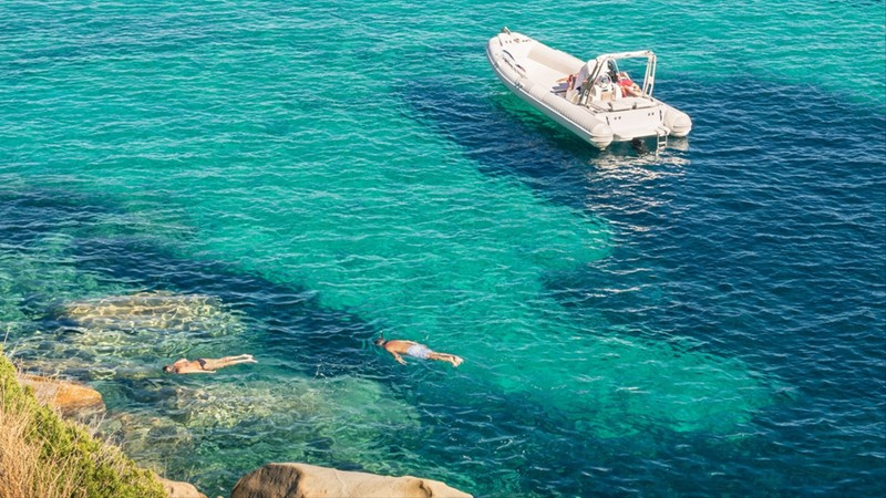 People snorkeling in exclusive exotic travel destination