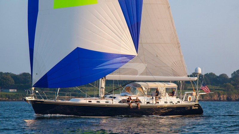 Destiny under sail with spinnaker