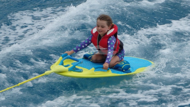 Younger guests having fun on the wakeboard - VIKING DREAM Charter Yacht