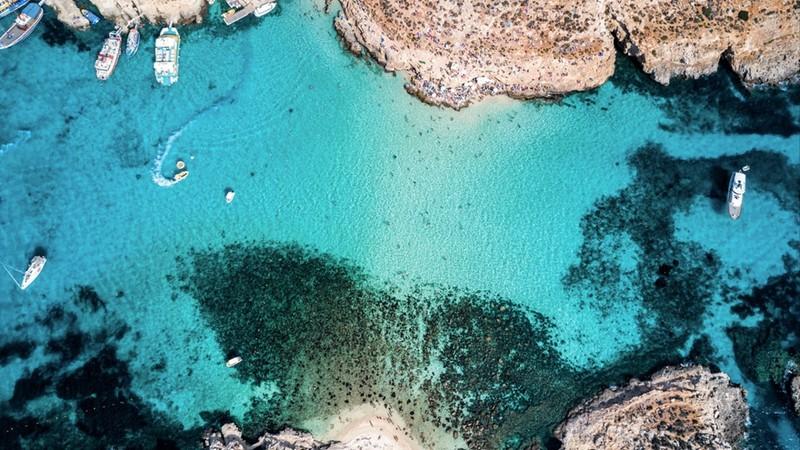 Aerial drone photo - The famous Blue Lagoon in the Mediterranean Sea. Comino Island, Malta.