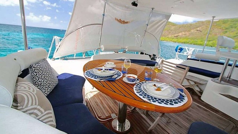 ISOLABLUE :: Aft Deck Dining with sun shades