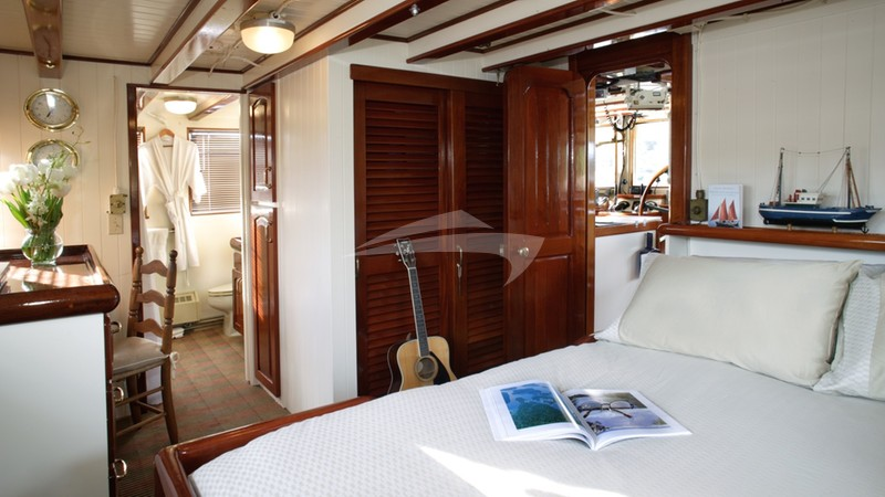 VIP Stateroom with Queen Bed on Upper Deck. View
