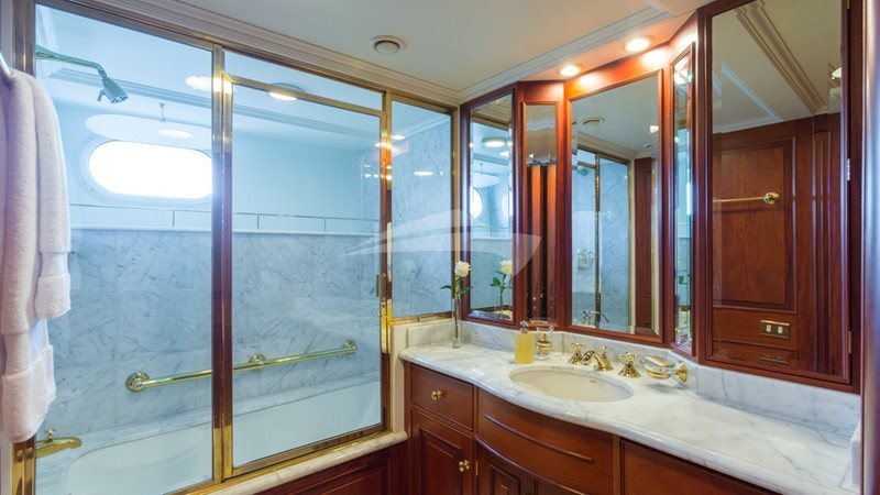 Lady J Guest Stateroom tub with shower overhead