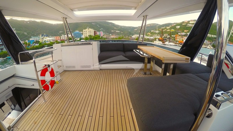 JAN'S FELION :: Spacious flybridge deck and lounging area.